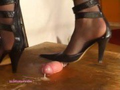 Beneath Indian Mistress Julie Singla's Soles who tramples cock with heeljob