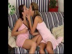 Lesbian Couple Playing On The Couch