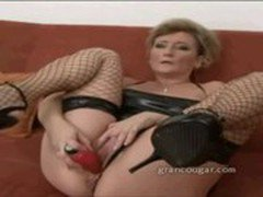 Cougar sucks on cock while using dildo on her pussy