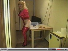 Cute Tranny in Red Vinyl Gets Head.