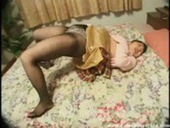 Horny Asian in pantyhose just can't be stopped from finger fucking