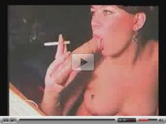 Whore Smokes Cigarette While Sucking A Dildo