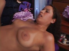 Busty brunette in red slurps on a long white cock