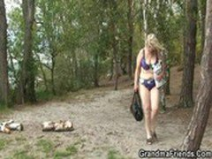 Old blonde bitch takes two cocks outdoors