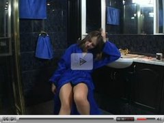 Ellen plays in the bathroom