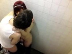 Teen couple caught fooling around in a locker room by a peeper