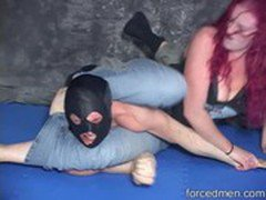 Red headed mistress beats a masked man in a mixed wrestling