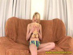 Blonde teen girl plays with dildo