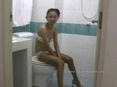 Thai Hooker Sucks Cock in the Toilet