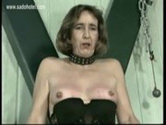Slave with clamps on her tits gets her pussy finger fucked bdsm