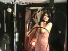 Horny mistress with big tits wearing latex hits slave on his back with a whip BDSM