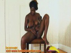 Voluptuous ebony babe fingers and squirts