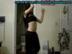 Asian girl belly dancing in a long black skirt