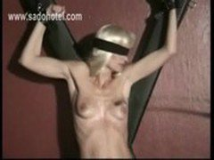 Mistress and master spanks beautiful blond slave on her ass and her tiny tits with a whip