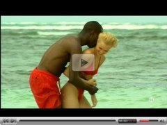 Young blonde white girl with black lover on the beach - Interracial