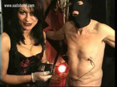 Dirty slave gets large meat hooks through is nipples and gets spanked by latex wearing mistress