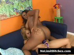 Ebony lesbian Melrose rides sistas strapon deep and fast