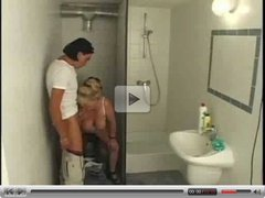 old slut gets it from 2 guys in a bathroom