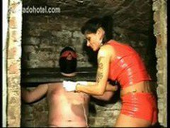 Masked Slave tied up in a dungeon gets his nipples electroshocked by horny mistress