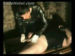 Mistress in latex burns balls with cigarrete of slave while give himself a handjob