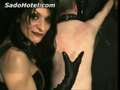 Slave in leather gets ass and back spanked by dominatrix