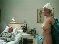 busty nurse tries to put her breasts' nipples on the mouth of a coma patient guy