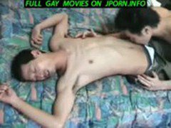 fit Japanese boy with big cock stroking it
