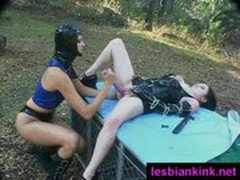 Perverse outdoor lesbian fetish play with a huge dildo and girls wearing latex