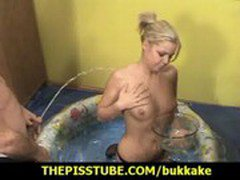 Cute blonde rubs her tits with warm pee