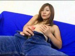 Brunette Girl In Jeans Jerking Off Her Fake Cock Licking Cum From Her Hand On The Couch