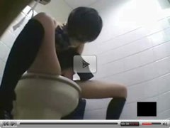 Japanese high school girl masturbates furiously in restroom