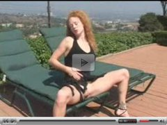Hottie redhead masturbating outdoors