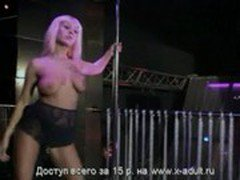 Blonde girl dancing in the club