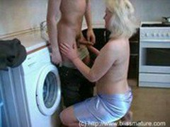 Russian Mom With Son In Kitchen