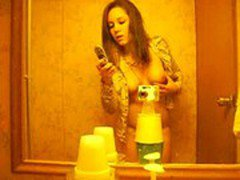 girl video taping herself in bathroom