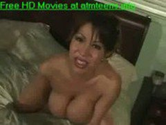 Busty asian babe gives titjob