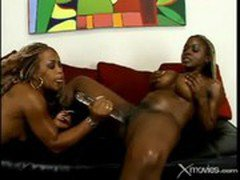 Two Black Babes Play Their Toys