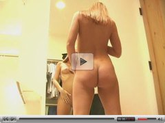HOT blonde teen massages herself with lotion in the mirror
