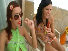 Two girls fingering snatches together
