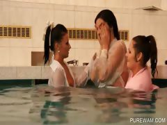 Lesbians getting wet in the pool