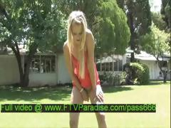 Mesmerising Blonde Doll Toying Outdoor
