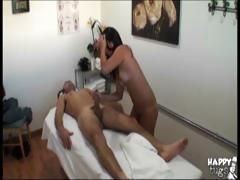 Cute Asian masseuse rides his dick