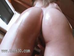 Huge silicon friend and oiled up woman