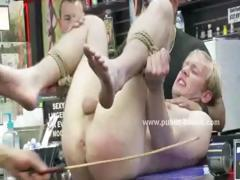 Blond and gay man gets his cock sucked in a public toilet after being tied up and humiliated