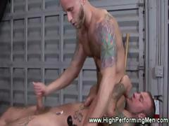 Tattood studs grabs each other cocks with their hands and mouth