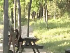 Blonde whore gets finger fucked in a park by a woman that hands her over to a horny  man