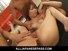 Japanese beauty shows off her spread pussy
