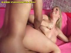 Horny blonde blows and gets banged by a black cock on pink couch