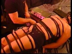 CBT Extreme Electrostim on my restrained and gagged bottom's cock and balls.