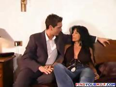 Busty Italina MILF in black stockings blows young man and fucks him